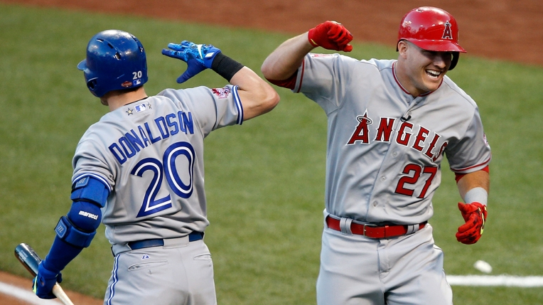CINCINNATI, OH - JULY 14: American League All-Star Mike Trout #27 of the Los Angeles Angels of Anaheim celebrates with teammate American League All-Star Josh Donaldson #20 of the Toronto Blue Jays after hitting a lead off home run in the first inning against National League All-Star Zack Greinke #21 of the Los Angeles Dodgers during the 86th MLB All-Star Game at the Great American Ball Park on July 14, 2015 in Cincinnati, Ohio. (Photo by Joe Robbins/Getty Images)